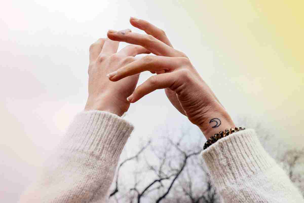 woman with hand in the air - self-care 101